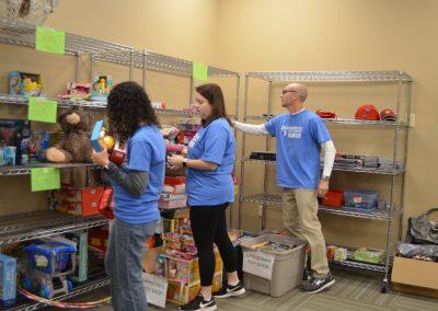 GDS' Julie Ayers, Jessica Bowron, & David Brian sorting toys