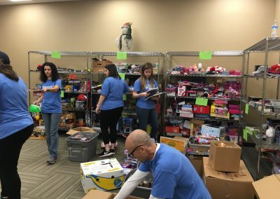 GDS Volunteers sorting and boxing toys